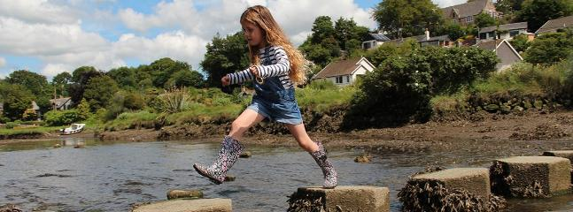 Children love playing on the Stepping Stones and fishing for tiddlers and crabs in the river