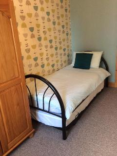 Has a pull out bed underneath.  Space limited so ideally for children