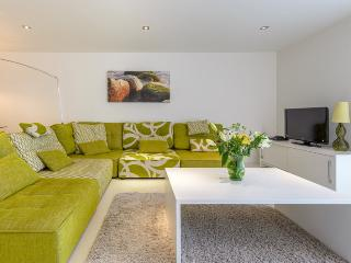 Open plan lounge with seating for four guests