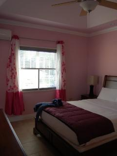 Pink Room. Upstairs with a queen sized bed