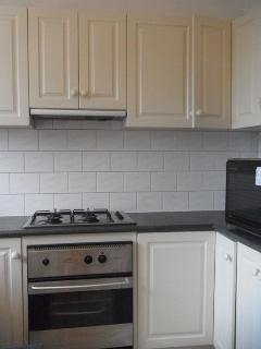 Kitchen with microwave, stove, oven, fridge,