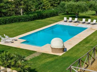Luxury villa with large swimming pool and beautiful manicured gardens