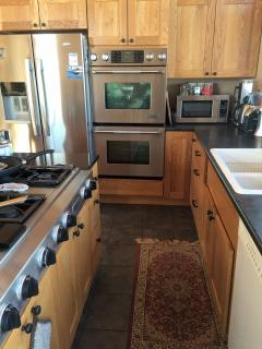 Double ovens jennair, stainless steel fridge, double sink, dishwasher, microwave.