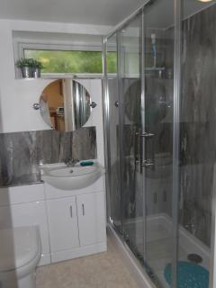 Bathroom with double shower cubicle and electric shower. No bath.