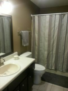 Second bath with tub/shower combo. Washer and dryer also on site in separate laundry.