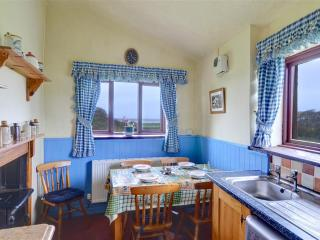 The kitchen diner is bright and cheerful, and includes the original range - but there is also an electric cooker!