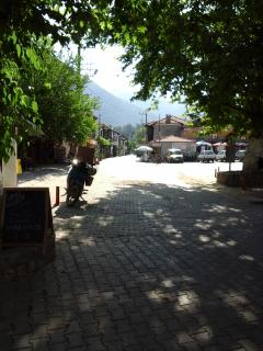 Uzumlu village square with bars, restaurants, supermarkets and cafes