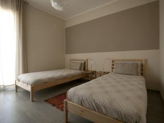 Camera da letto on due letti singoli che si possono unire in un matrimniale