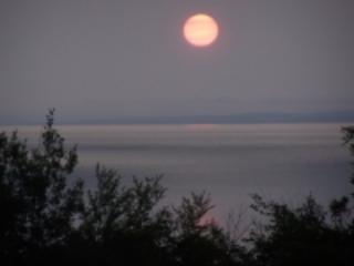 Moonrise over Minas Basin as seen from the apartment balcony.