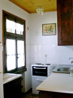 The kitchen with a view to the sea.