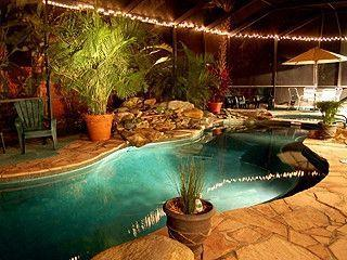 private tropical garden home with waterfall pool., Holmes Beach