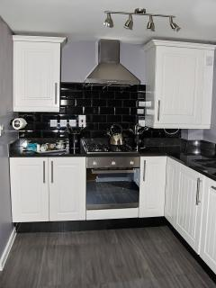 Fully equipped kitchen including dishwasher, washing machine, fridge freezer, microwave, toaster
