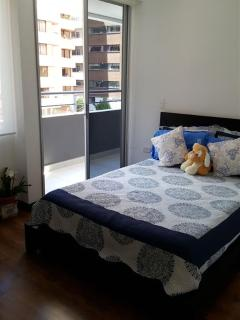 2nd bedroom with access to balcony