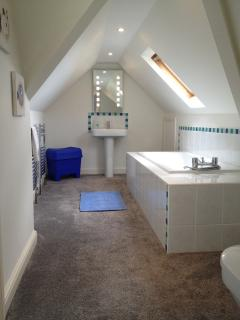 Upstairs linked-En-suite bathroom with hand shower over servicing double & twin.