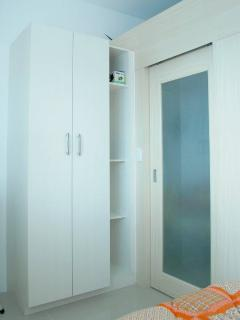 The bedroom has a sliding door divider, but won't block the cool air from the airconditioning unit.