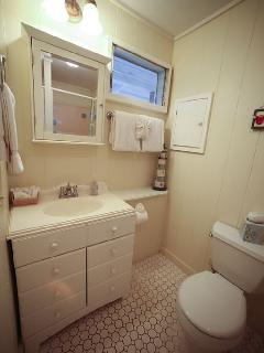 Bathroom with small bathtub and all amenities provided for you. Soap,shampoo,etc