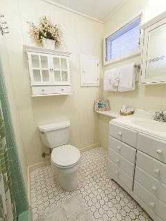 Second bathroom with original tile and shower. Nice.