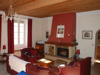 Spacious yet cosy sunny Livingroom with wood burning stove, reading corner & main dining table for 8