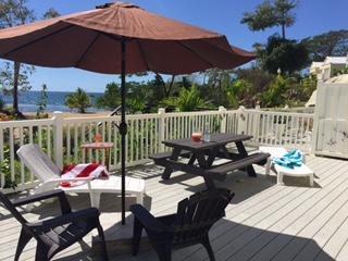 Sundeck with picnic table. Perfect for family brunch and private sunbathing