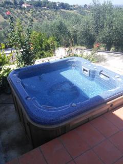 Hot tub on terrace.