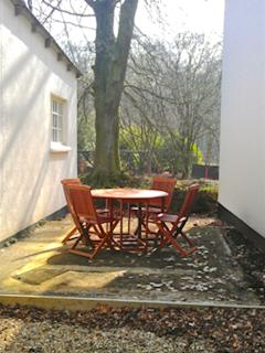 Private Patio overlooking rural countryside a small stream leading to the River Exe
