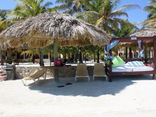 Sandy Beach Lagoon with Beach Beds Shaded Palapa's with lounge chairs