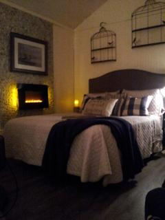 Cozy up with the lake stone, bedside fireplace.