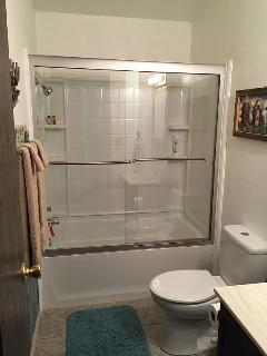 View of shower of the large main bathroom which has luxurious over sized towels of 100% cotton.