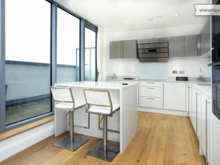 A super sleek two-bedroom penthouse, just east of the City, near Canary Wharf., London