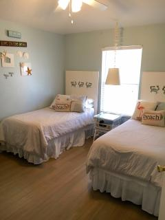 two twin beds and TV dresser bamboo floors