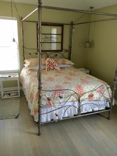 queen bed and bamboo floors