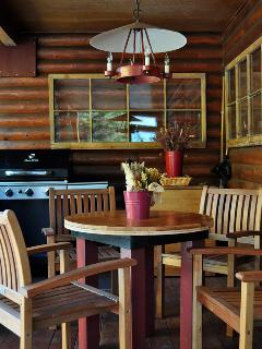 eat outside on the covered porch with a view of the 'oasis' aspens, pines and flowers