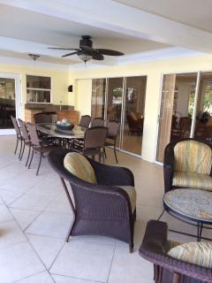 Outdoor living at its best.  Dining poolside   Seats 12