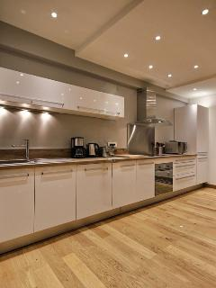 KITCHEN:The 24 sqm  kitchen is equipped with fridge,freezer,dishwasher, Induction hob,oven.