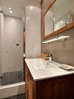 BATHROOM 1:The 5 sqm bathroom equipped with bathbasin,shower,toilet,tiled floor,1seperated toilet.