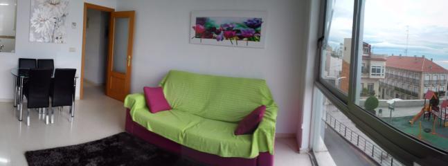 salón - comedor con sofá cama