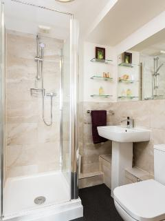 En suit shower room adjoining Master Bedroom. Recently refurbished, and very private.