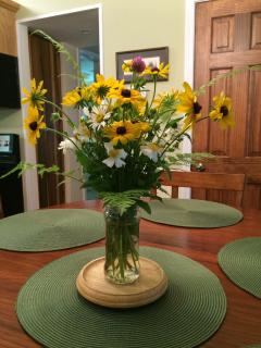 A fresh bouquet of meadow flowers greets guests when in season.