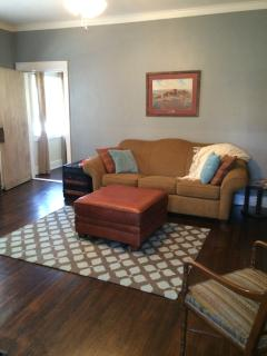 additional space available for an extra fee, living area with sleeper sofa and tv