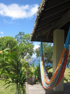 Relax in a comfy hammock and enjoy the view of the ocean and tropical gardens...bliss!