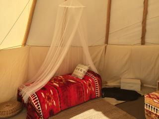 Up to 3 single beds, or two singles + 1 cot can be added inside your teepee.