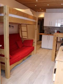 Sofa bed with single bunk bed overhead