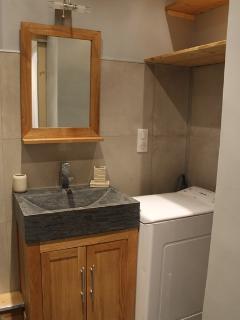 Washing machine and shelf storage in bathroom