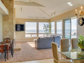 Oceanfront views, three balconies & steps from the beach!