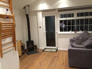 Spacious studio with log burner