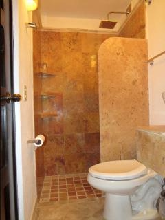 Ensuite with peach marble walls and counters & white marble bowl sink. Rain forest shower head.