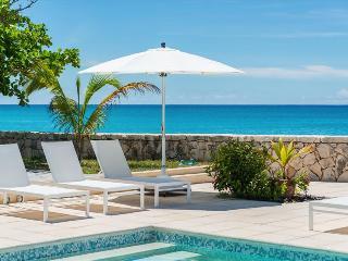 Beachfront 4 bedroom villa at Plum bay beach.