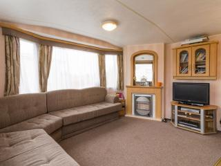 Spacious lounge area  book this caravan for your family holiday.