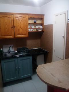 Kitchen area. Induction fires for easy and fast cooking / Zona de la cocina. Placa de inducción