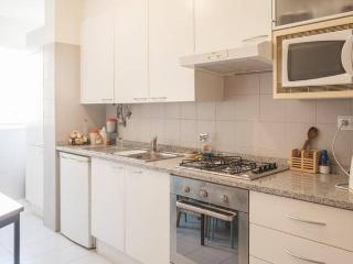 Kitchen equipped with tableware and microwave